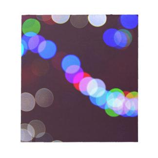 Colorful bokeh lights notepad