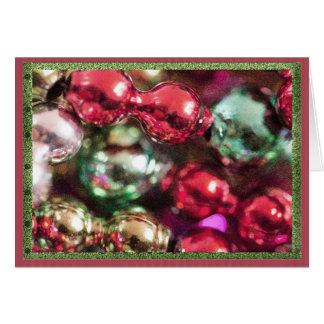 Colorful Christmas beads. Greeting Card