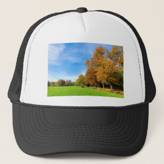 Colorful fall landscape with trees sky and meadow trucker hat