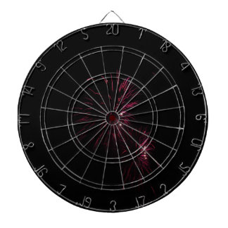 Colorful fireworks of various colors in the night dartboard