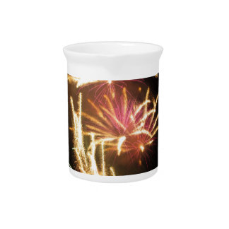 Colorful fireworks of various colors light up the beverage pitchers