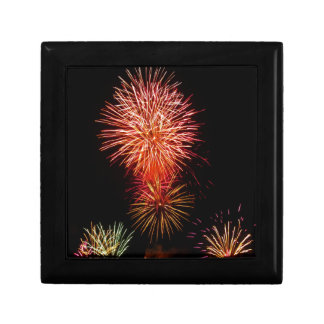 Colorful fireworks of various colors light up the small square gift box