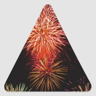 Colorful fireworks of various colors light up the triangle sticker