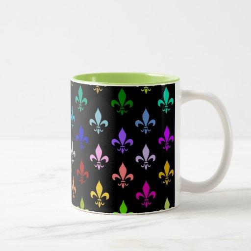 Colorful fleur de lis pattern on black mug