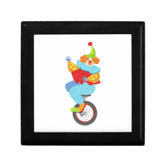 Colorful Friendly Clown Balancing On Unicycle Gift Box