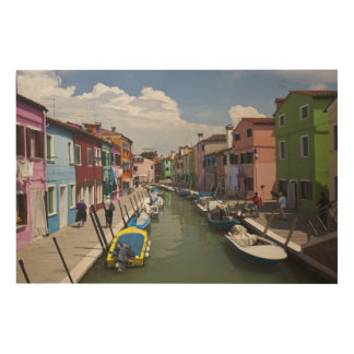 Colorful homes along canal on the island of wood canvases
