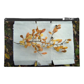 Colorful leafy branch surrounded by fallen leaves travel accessories bag