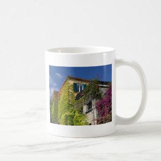 Colorful leaves on house coffee mug