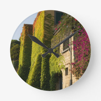 Colorful leaves on house walls clock