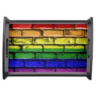 Colorful LGBT rainbow pride flag brick wall Serving Tray