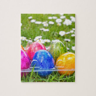 Colorful painted easter eggs in grass with daisies jigsaw puzzle