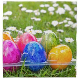 Colorful painted easter eggs in grass with daisies napkin