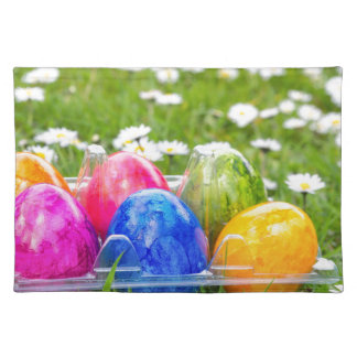Colorful painted easter eggs in grass with daisies placemat