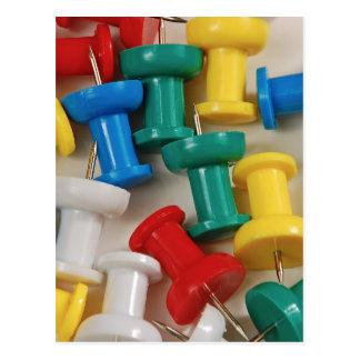 Colorful plastic push pins postcard