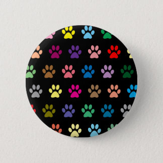 Colorful puppy paw prints on black 6 cm round badge