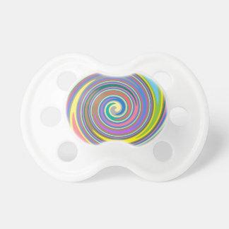Colorful rainbow swirl pattern pacifiers
