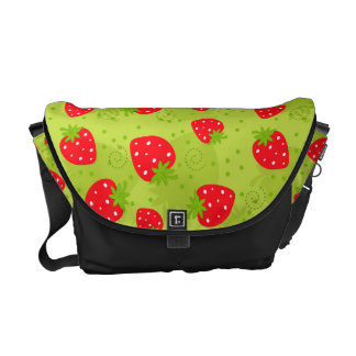 Colorful red strawberry pattern on green commuter bag