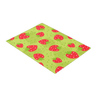 Colorful red strawberry pattern on green doormat