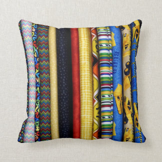 Colorful Rolls of Various Fabrics Cushion