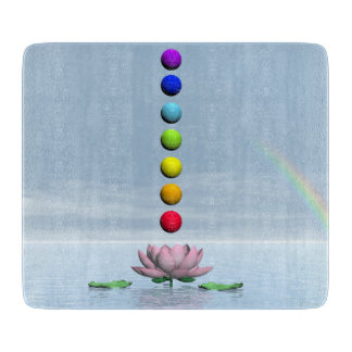Colorful spheres for chakras upon beautiful lily f cutting board