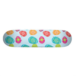 Colorful Spring Easter Eggs Pattern on Baby Blue Skateboard Decks