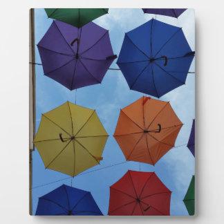 Colorful umbrellas plaque