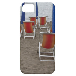 Colorful wooden chairs at sand beach iPhone 5 cover