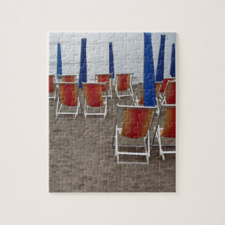 Colorful wooden chairs at sand beach puzzles