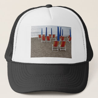 Colorful wooden chairs at sand beach trucker hat