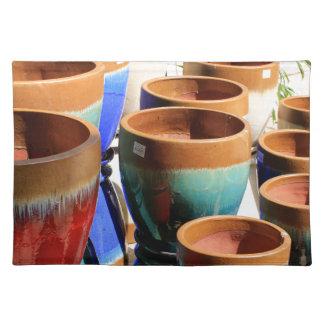 Coloured garden plant pots place mats