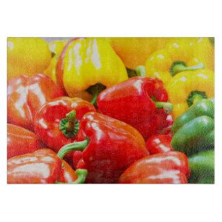 Colourful capsicums cutting board