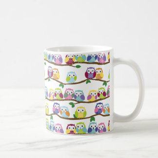 Colourful owls on a branch coffee mug