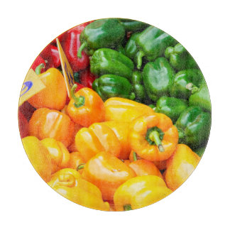 Colourful red, green and yellow capsicums cutting board