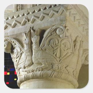 Column capital bearing symmetrically arranged grot square sticker
