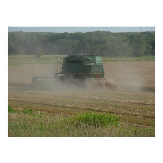 Combine harvester in Wheat Field Poster