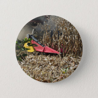 Combine harvesting corn crop in cultivated field 6 cm round badge