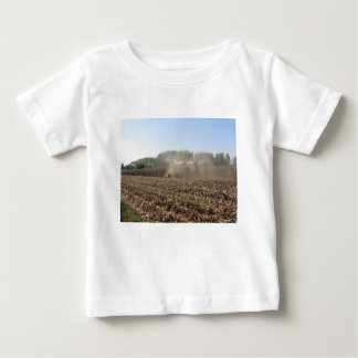 Combine harvesting corn crop in cultivated field baby T-Shirt