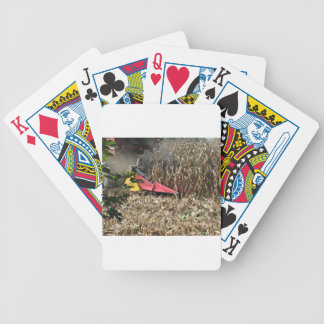 Combine harvesting corn crop in cultivated field bicycle playing cards