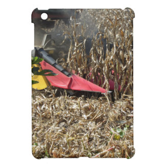 Combine harvesting corn crop in cultivated field case for the iPad mini