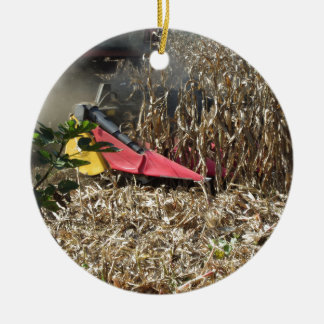 Combine harvesting corn crop in cultivated field ceramic ornament