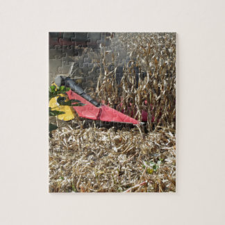 Combine harvesting corn crop in cultivated field jigsaw puzzle