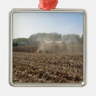 Combine harvesting corn crop in cultivated field metal ornament