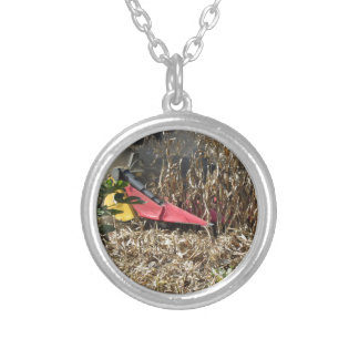 Combine harvesting corn crop in cultivated field silver plated necklace