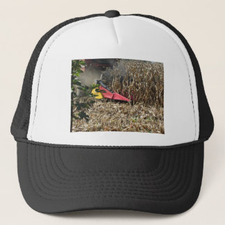 Combine harvesting corn crop in cultivated field trucker hat