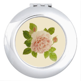 Compact mirror of rose of beige pink