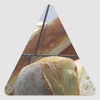 Composition with different types of baked bread triangle sticker