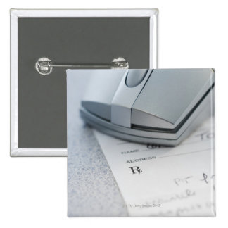 Computer mouse on written prescription 15 cm square badge