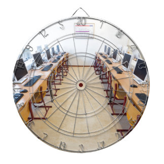 Computers in classroom of dutch education dartboard with darts