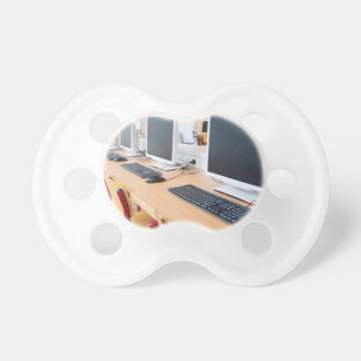Computers in classroom on high school baby pacifiers