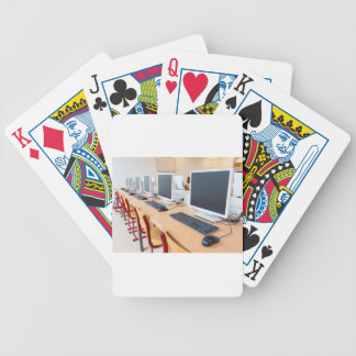 Computers in classroom on high school bicycle playing cards